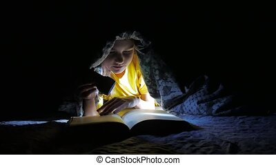 child teen reading girl reads book at night with flashlight...