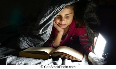 child teen reading girl reads book dog at night with...