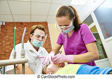 Child teeth treatment under sedation - child dentist treat...