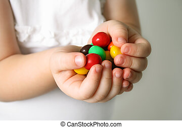 Child the hands the candies - Bubble Gums in the hands of...