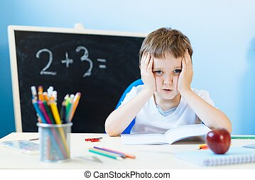 Child thinking about homework solution