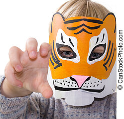 child tiger mask pretending - child with tiger mask. kid...