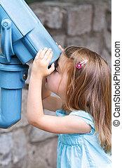 Child Tourist - Little girl looks intently through ...