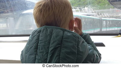 Child traveling in subway train