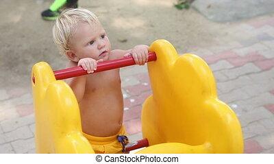 child tries to climb the rocker