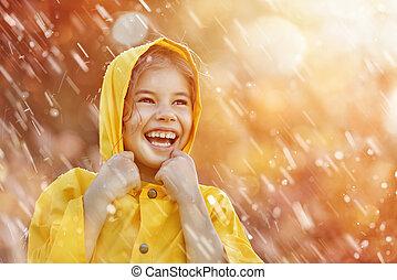 child under autumn rain - Happy funny child under the autumn...