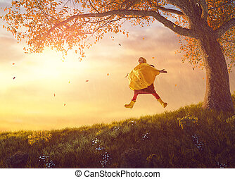 child under the autumn shower - Happy funny child under the...