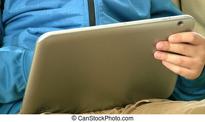 Child Using a Touch Screen Tablet