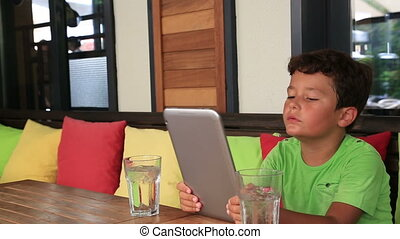 Child using digital tablet at the r