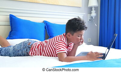 Child  using laptop computer