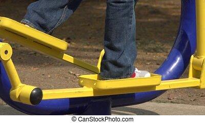 Child Using Step Machine