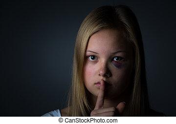 Child victim - Teenage girl giving the shush sign.