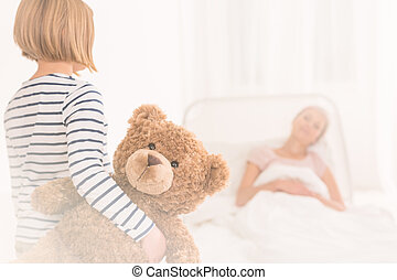 Child visiting mother at hospital
