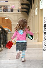 child walk with bags