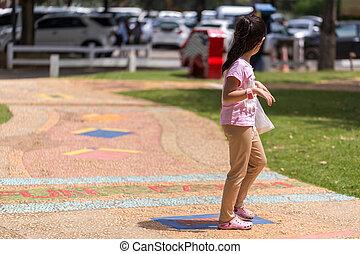 Child Walking in Park