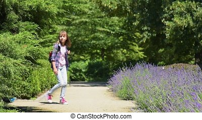 Child walking in park - Two child - girl and boy walking in...