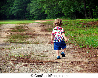 Little girl / child walking up a dirt road all alone