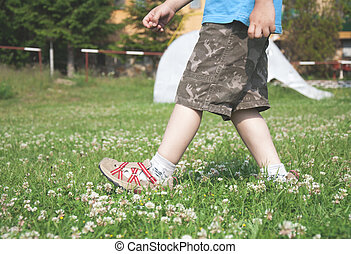 Child walking on the meadow
