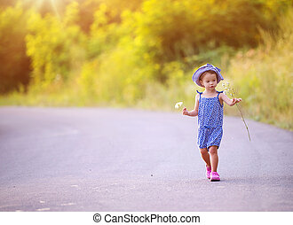 Child walking on the road
