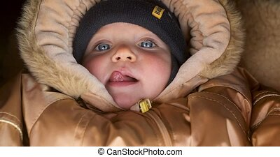 Child warm clothes sticking his tongue out - Cute baby...