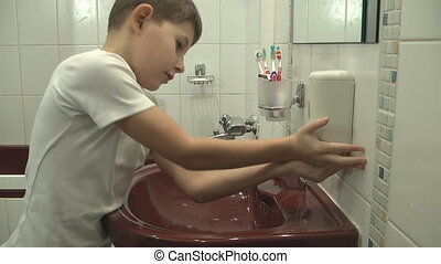 child washes with soap