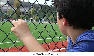 Child watching football match - Soccer fan watching match...