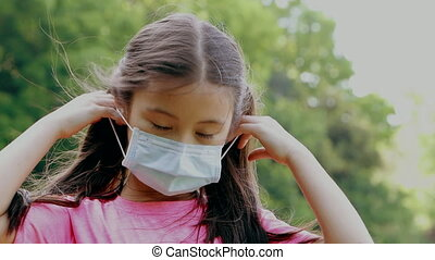 child wear face mask during coronavirus and flu