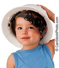 Child wearing hard hat