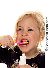 Child when brushing teeth. Toothbrush and toothpaste - Child...