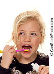 child while brushing your teeth. toothbrush and toothpaste -...
