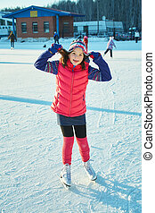 child winter outdoors on ice rink