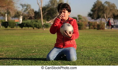 Child with a ball