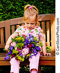 child with a bouquet of flowers. gift for mother