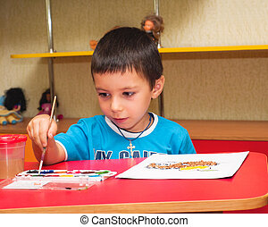 Child with a brush for drawing - Child for drawing in a...