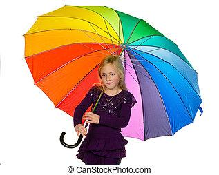 child with a colorful umbrella