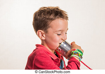 child with a dosentelefon - child listens in a tin can phone...