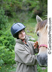 Child with a horse