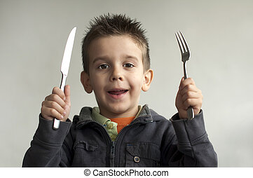 Child with a knife and fork