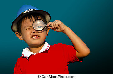 Child with a magnifying glass