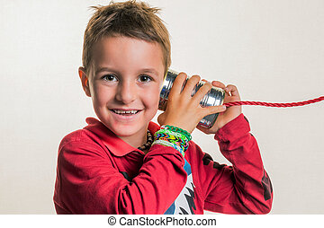 child with a play telephone