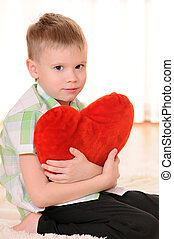 child with a plush heart