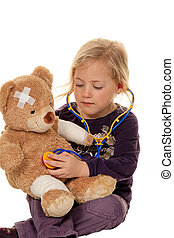 child with a stethoscope as a medical doctor.