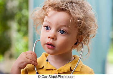 Child with a stethoscope