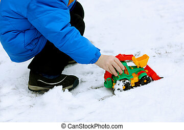 child with a toy bulldozer