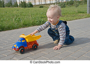 Child with a toy truck