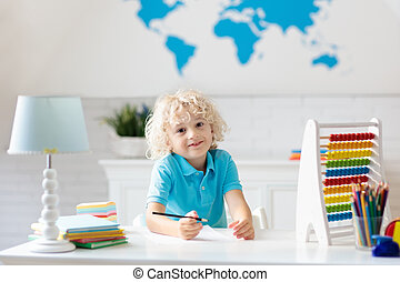 Child with abacus doing homework after school.