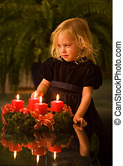 Child with Advent wreath at Christmas
