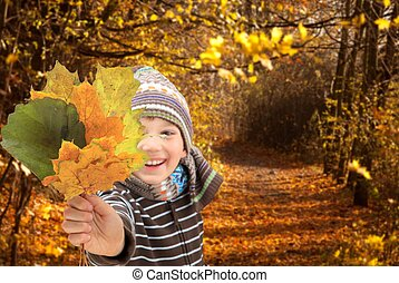 Child with Autumn leaves