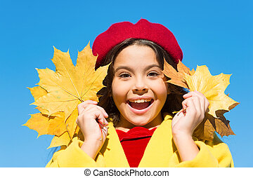 Child with autumn maple leaves walk. Autumn coziness is just around. Autumn warm season pleasant moments. Kid girl smiling face hold leaves sky background. Little girl excited about autumn season