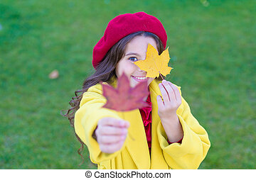 Child with autumn maple leaves walk. Autumn coziness is just around. Little girl excited about autumn season. Autumn warm season pleasant moments. Kid girl smiling face hold maple leaves